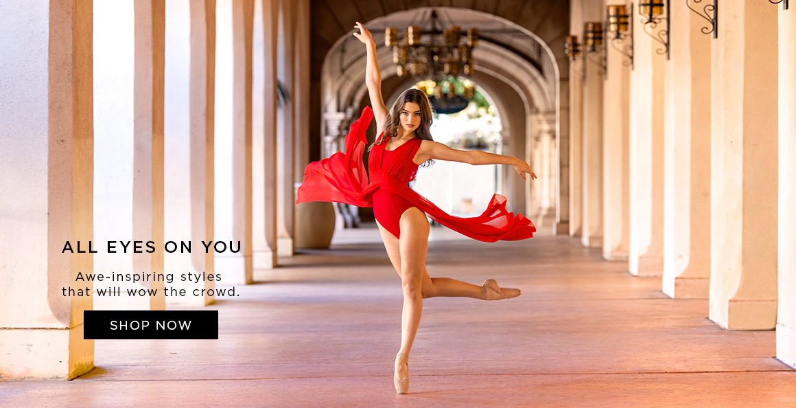 Image of a dancer dacing in a red dress.