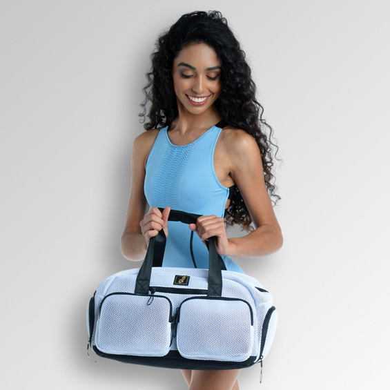 Photo of dance carrying a Danznmotion bag accessories.